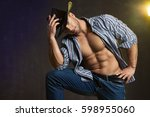 sexy western man with hat | Shutterstock . vector #598955060
