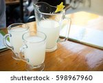Pitcher And Glasses Of Pulque ...