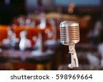 retro karaoke microphone on... | Shutterstock . vector #598969664