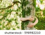 tree hugging. close up of hands ... | Shutterstock . vector #598982210