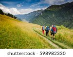 Hikers Walking In The Mountain...