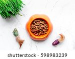 Stock photo dry cat food in bowl on stone background top view 598983239