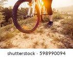 girl on mountain bike rides on... | Shutterstock . vector #598990094
