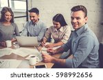 beautiful business people are... | Shutterstock . vector #598992656