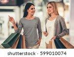 beautiful girls with shopping... | Shutterstock . vector #599010074