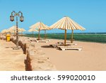 empty beach with sunbeds and...   Shutterstock . vector #599020010