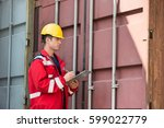 male worker inspecting cargo... | Shutterstock . vector #599022779