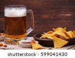 glass of beer. nachos chips.... | Shutterstock . vector #599041430