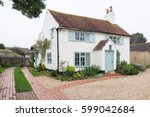 cottage in an english village | Shutterstock . vector #599042684