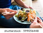 close up of the hands of a... | Shutterstock . vector #599056448