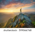 Stock photo silhouette of a champion on mountain peak active life concept 599066768