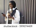 afro american teen hipster girl ...   Shutterstock . vector #599074409