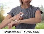 woman spraying insect repellent ...   Shutterstock . vector #599075339