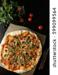 italian pizza with anchovies ... | Shutterstock . vector #599099564