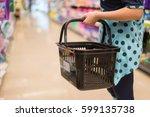 female hand  holds a shopping...   Shutterstock . vector #599135738