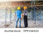 two business man construction... | Shutterstock . vector #599146424