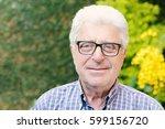 portrait of an old man sitting... | Shutterstock . vector #599156720