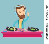 caucasian dj in headphones at... | Shutterstock .eps vector #599212784