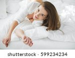 beautiful woman in bed | Shutterstock . vector #599234234