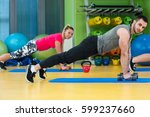 group of people working out in... | Shutterstock . vector #599237660