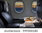 tray of food on the airplane ... | Shutterstock . vector #599300180