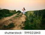 little girl dancing in the... | Shutterstock . vector #599321843