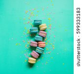 macaron dessert on a turquoise... | Shutterstock . vector #599333183