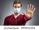 handsome man showing gesture ... | Shutterstock . vector #599351054