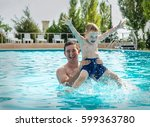 father and son funny in  water... | Shutterstock . vector #599363780