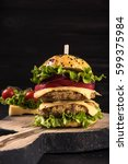 double burger on the board on... | Shutterstock . vector #599375984