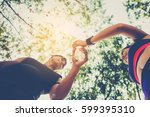 man runner giving bottle of... | Shutterstock . vector #599395310