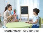 young woman teacher and little... | Shutterstock . vector #599404340