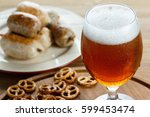 a glass of cold foamy beer with ...   Shutterstock . vector #599453474