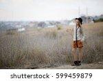 sad girl with long beautiful...   Shutterstock . vector #599459879