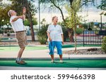 retired couple having fun... | Shutterstock . vector #599466398