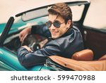 fashion man sitting in luxury... | Shutterstock . vector #599470988