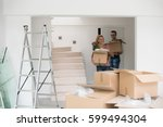 happy young couple unpacking or ... | Shutterstock . vector #599494304