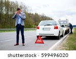man calling while tow truck... | Shutterstock . vector #599496020