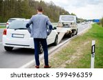 man calling while tow truck... | Shutterstock . vector #599496359