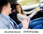 driving instructor and woman... | Shutterstock . vector #599496386