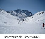 people of all ages ski down a... | Shutterstock . vector #599498390