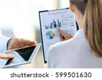 business colleagues working and ... | Shutterstock . vector #599501630