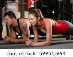 sporty young couple work out... | Shutterstock . vector #599515694