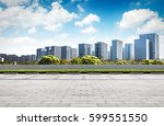asphalt road and modern city | Shutterstock . vector #599551550