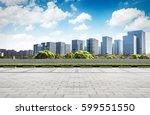 asphalt road and modern city | Shutterstock . vector #599551550