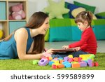 side view of a mom and toddler... | Shutterstock . vector #599589899