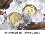 beer cans chill in ice | Shutterstock . vector #599592098