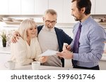 positive aging couple owners... | Shutterstock . vector #599601746