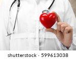 doctor holding plastic heart in ... | Shutterstock . vector #599613038