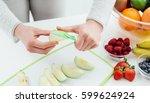woman preparing fruit in her... | Shutterstock . vector #599624924